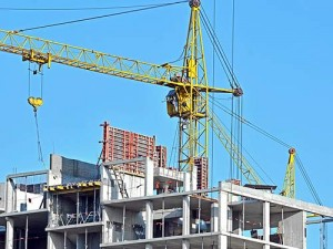 large construction crane above a multistory construction project