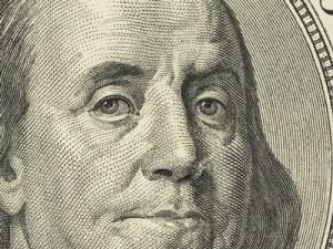 Closeup of Benjamin Franklin on the hundred dollar bill