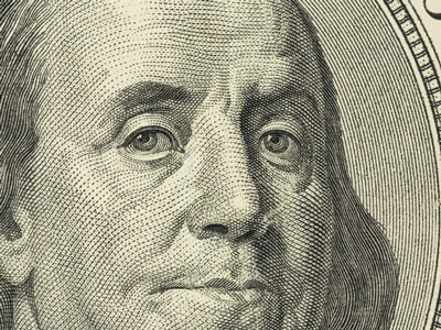 closeup of Benjamin Franklin on $100 bill
