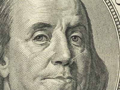 closeup of Benjamin Franklin on $100 bill