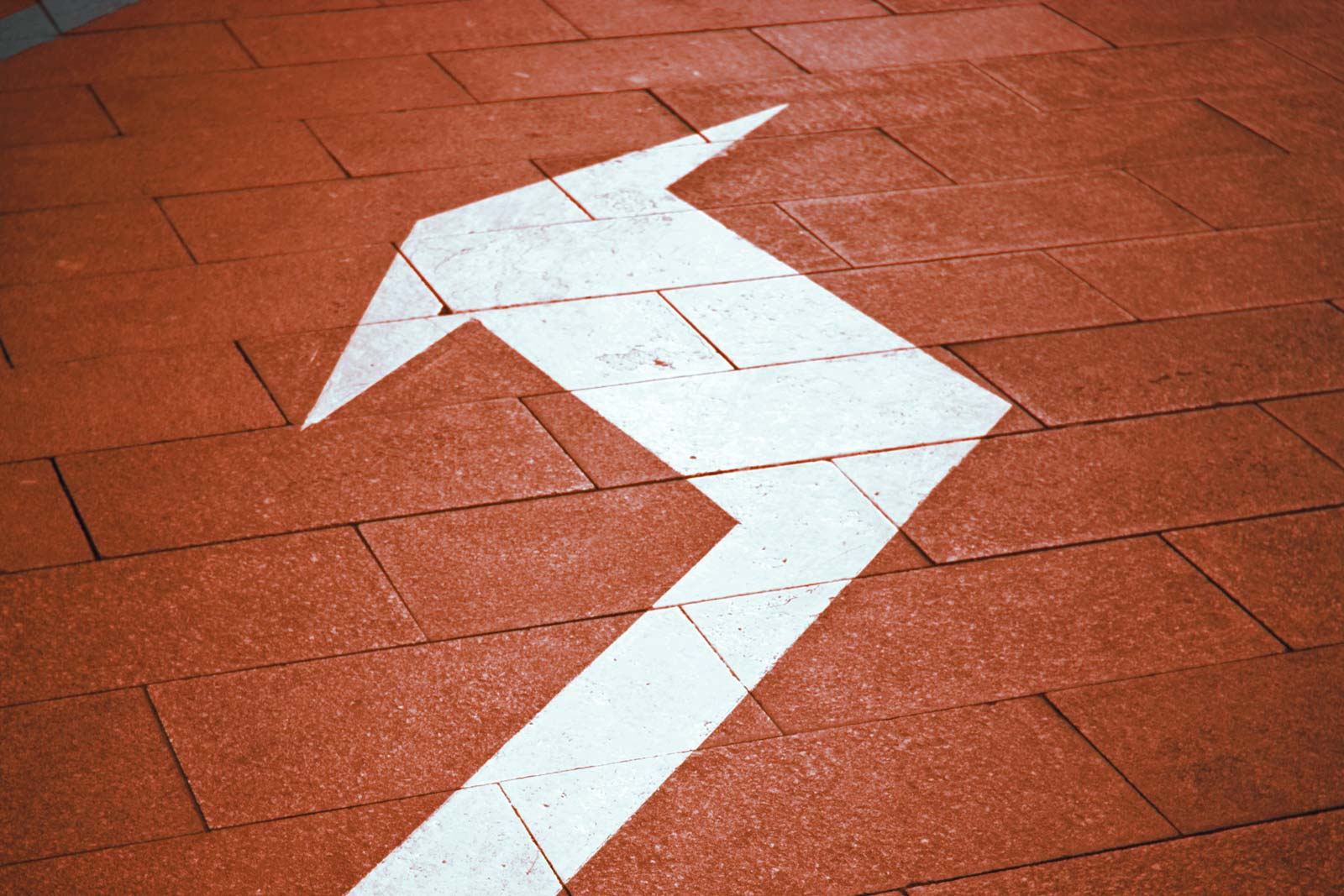 Large arrow on floor indicating a change in direction