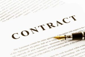 A contract with a fountain pen laying on top of it