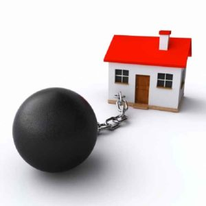 a toy house attached to a ball & chain