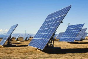 Large solar panels set up in an arid field