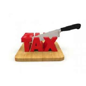 a knife cutting the word tax on a cutting board