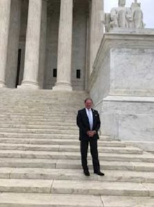 Attorney Ron Holmes standing on the steps of the US Supreme Court