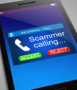 smartphone screen with a Scam Call alert as the phone rings