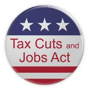 American flag design lapel button that says Tax Cuts and Jobs Act