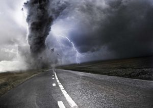 Tornado raging above an empty road