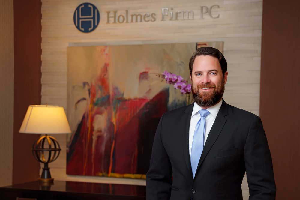 Dallas attorney Kevin C. Moran standing in the foyer of The Holmes Firm