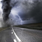 Tornado raging above an empty road