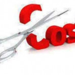 scissors cutting through the word cost