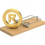 Registered Trademark symbol sitting on a mousetrap